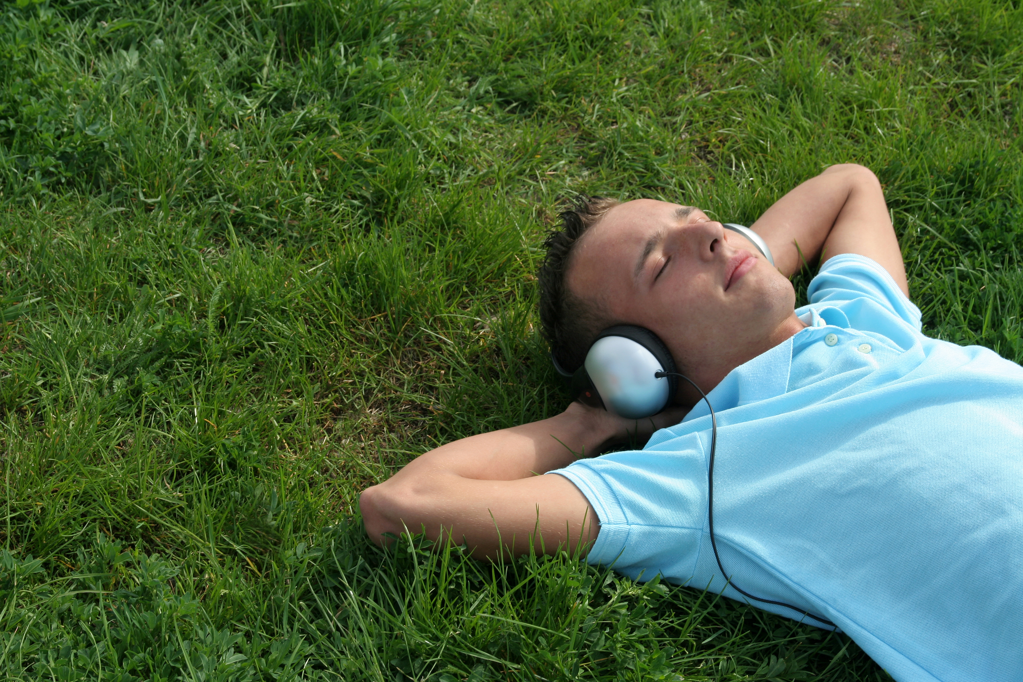 bigstockphoto_Young_Man_Listening_To_Music_556416